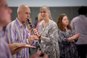 Fabian Bautz plays the clarinet for a movement exercise.