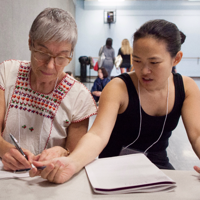 At the 2018 National Conference, attendees compare notes between sessions.